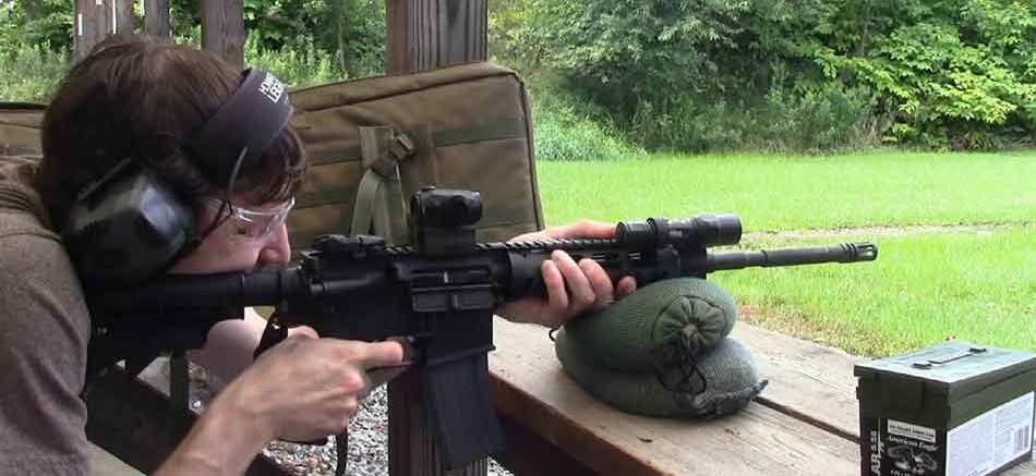 Sig Sauer Romeo5 shown on AR15 rifle on firing range