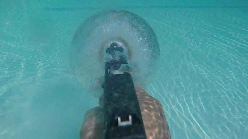 A glock being fired underwater
