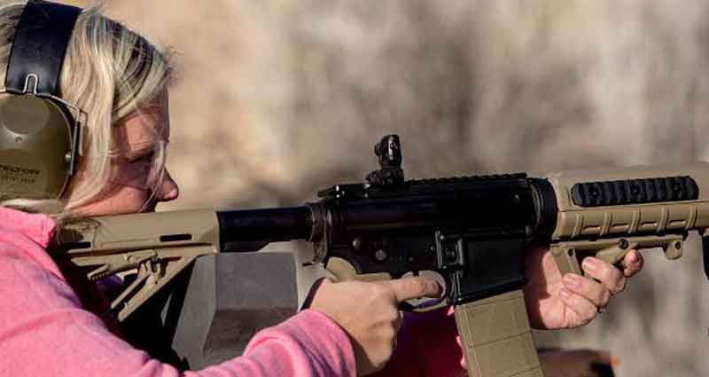 young girl with an AR15