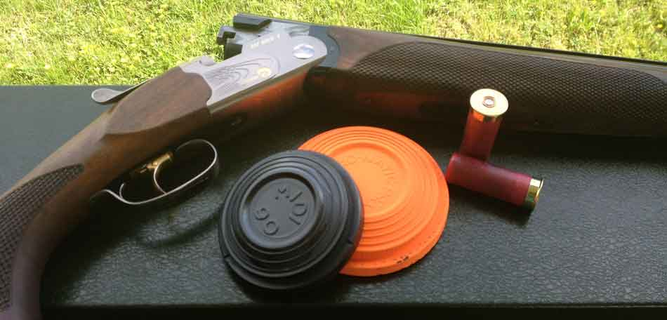 a clay pigeon shotgun plus some clays and cartidges