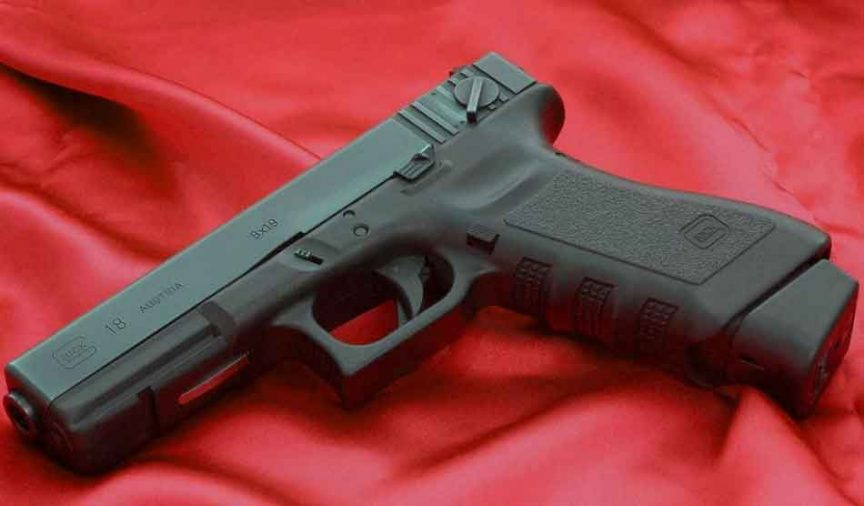 A glock 18 on red velet