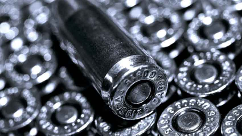A close up of a 9mm round in a box black and white photo