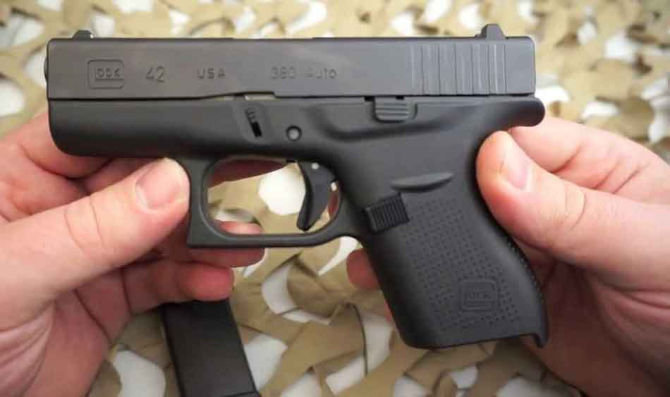 A held Glock 42 between hands