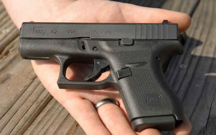 a glock 42 in the palm of a hand