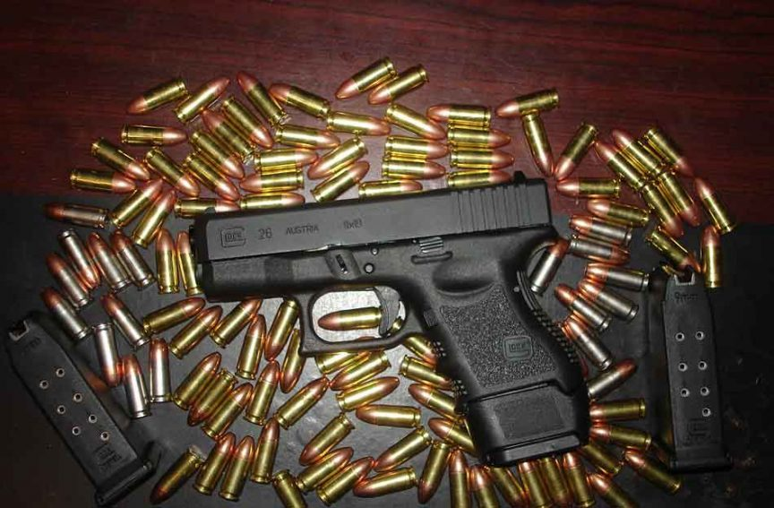 a glock with bullets around
