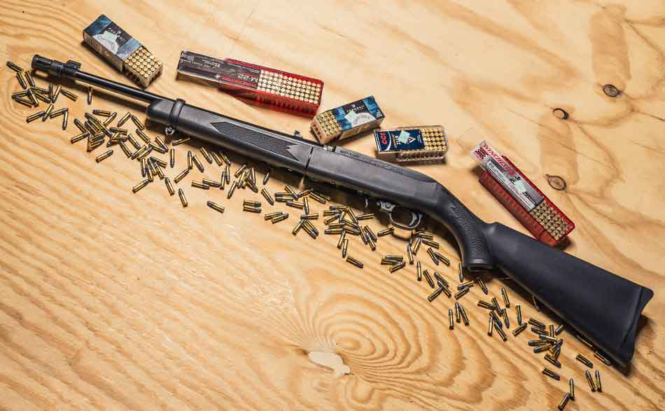A rifle surrounded by 22lr ammunition
