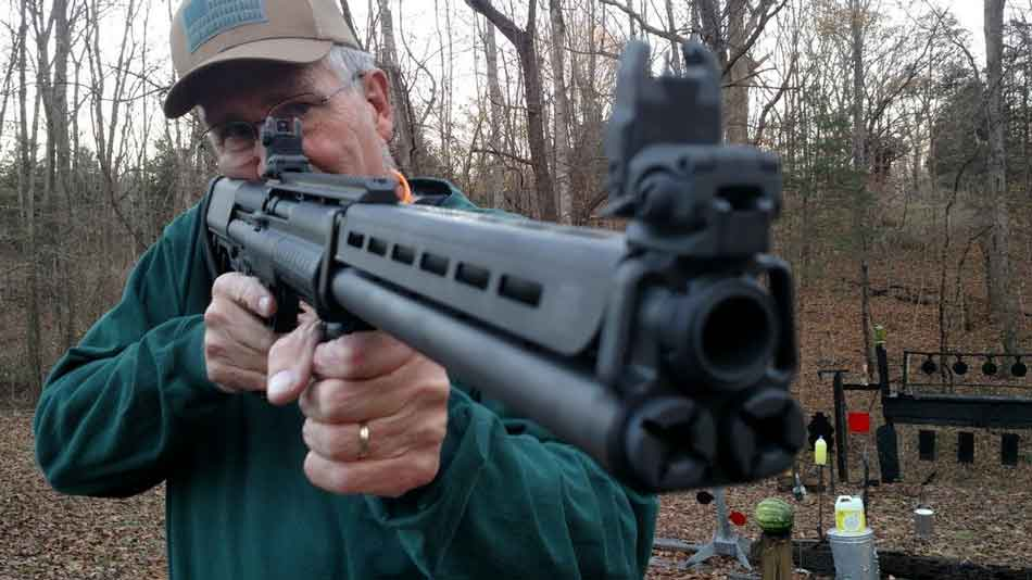 The Kel-Tec KSG-25 shotgun close up front view shouldered