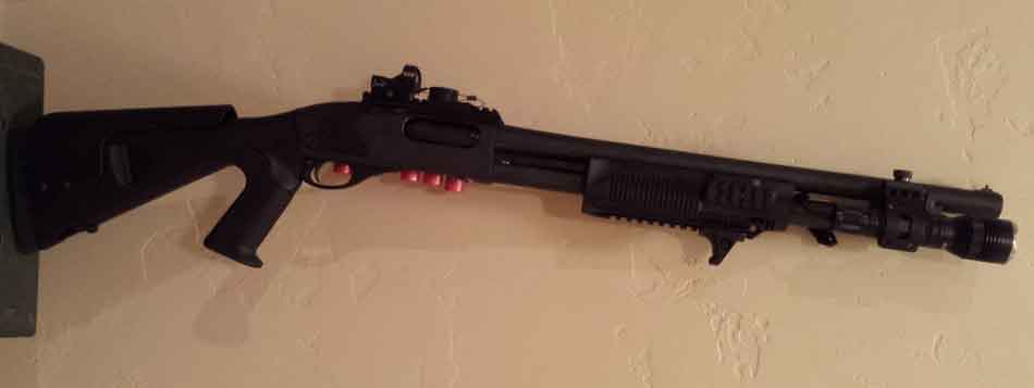 A tactical Remington 870 hanging on the wall