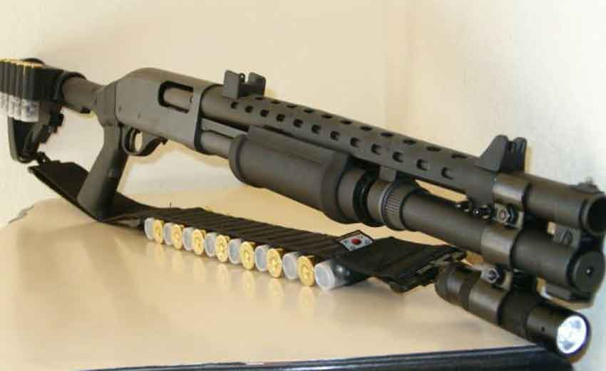 A tactical Remington 870 with cartridges in the sling