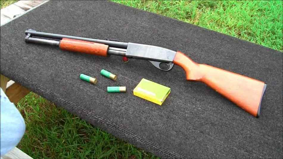 a 12 gauge pump action shotgun on outdoor table