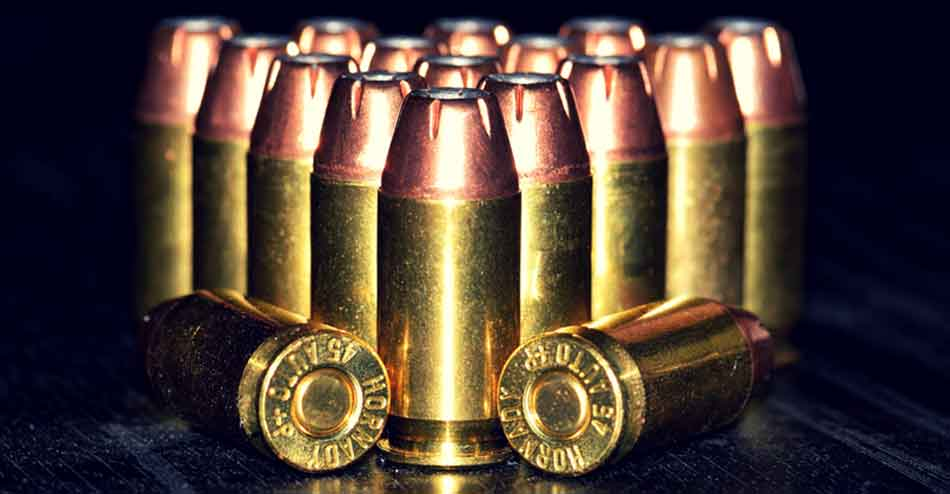 a close up of 45 rounds standing up