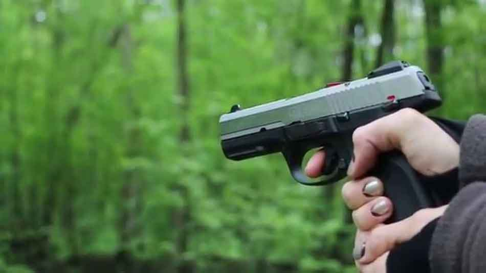a 9mm pistol held in the woods