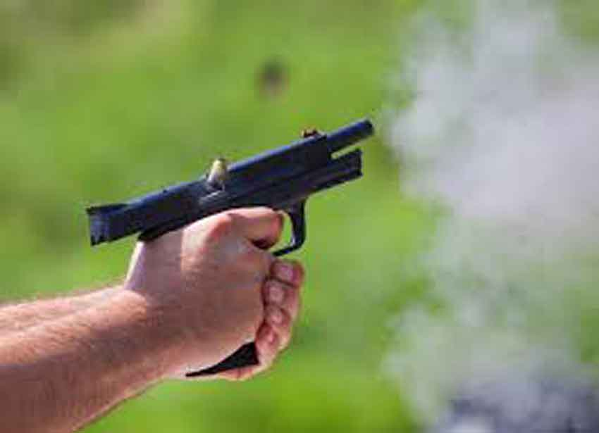 a 9mm pistol ejecting a cartridge with smoke