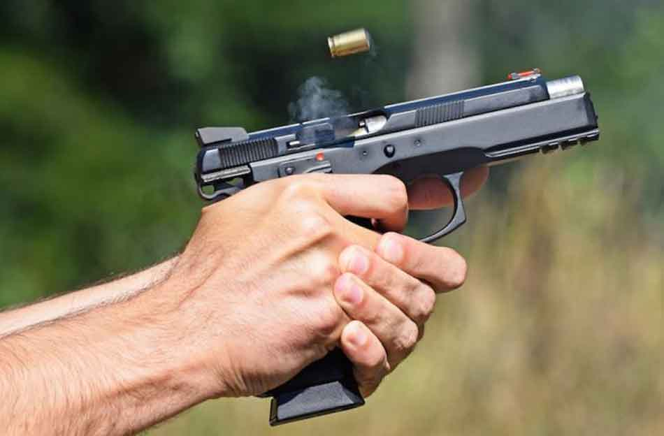 a 9mm pistol ejecting a cartridge