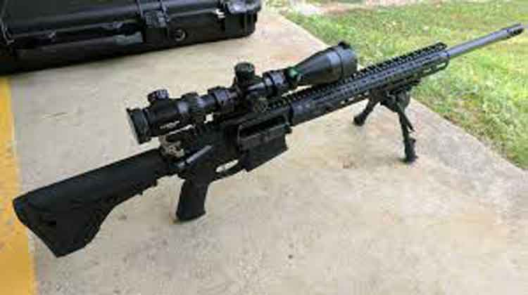an AR-10 on a bipod in a range with sniper scope