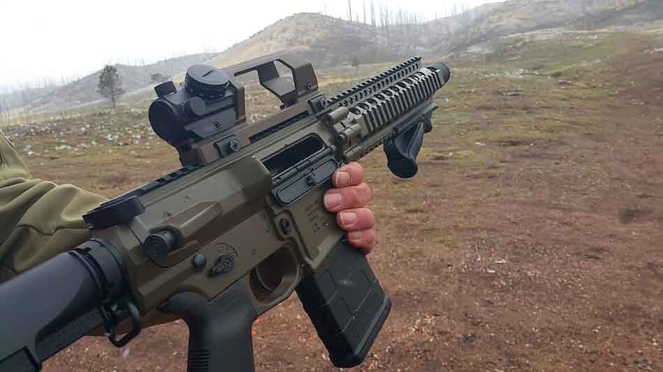 an AR-10 being carried on a range
