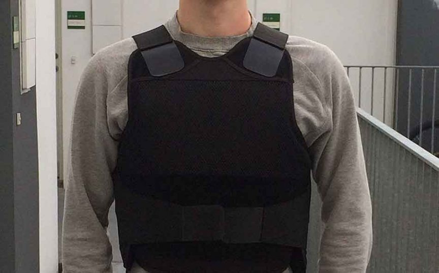 a close up of a bulletproof vest on a man