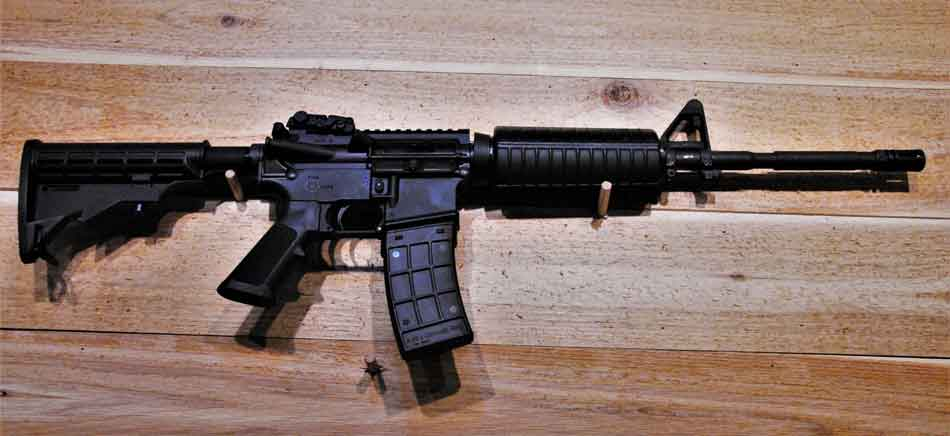 a Colt M4 hanging on the wall