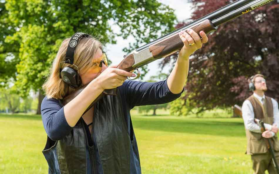a female skeet shooter aiming
