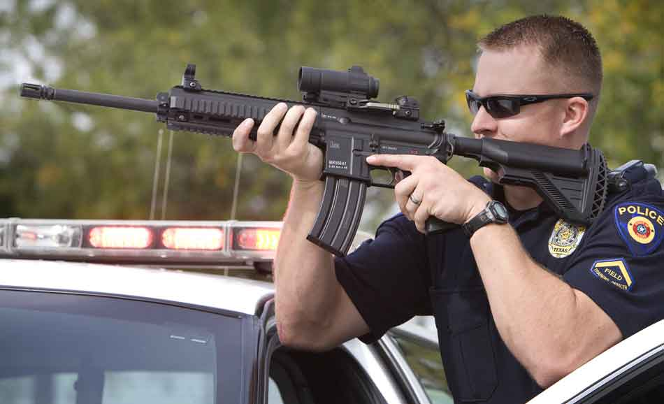 a MR556 held by a police officer