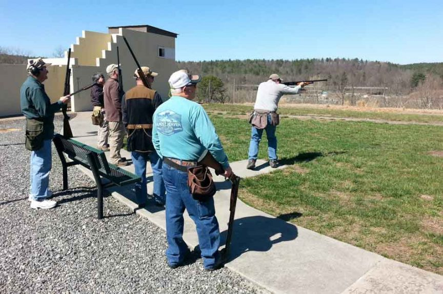 some shooters playing a round at skeet shooting
