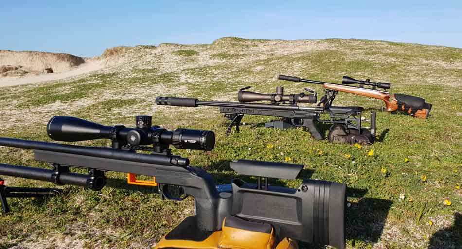 A selection of 308 Winchester rifles on an outdoor range