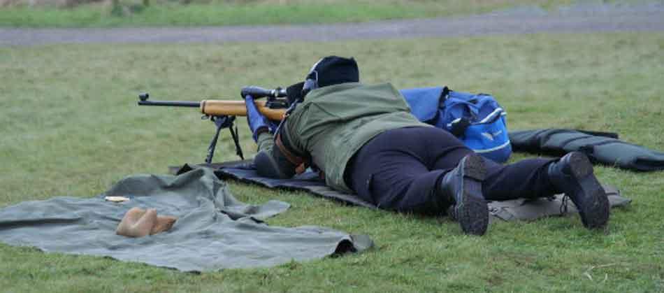 a man boresighting a rifle
