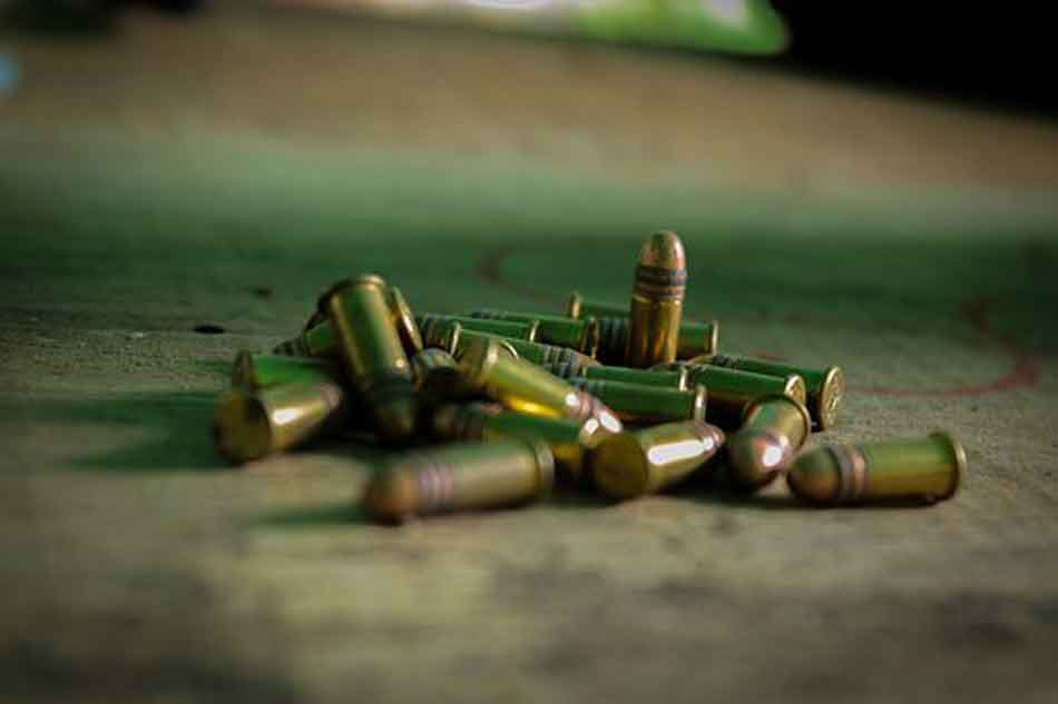 a pile of ammunition on wood