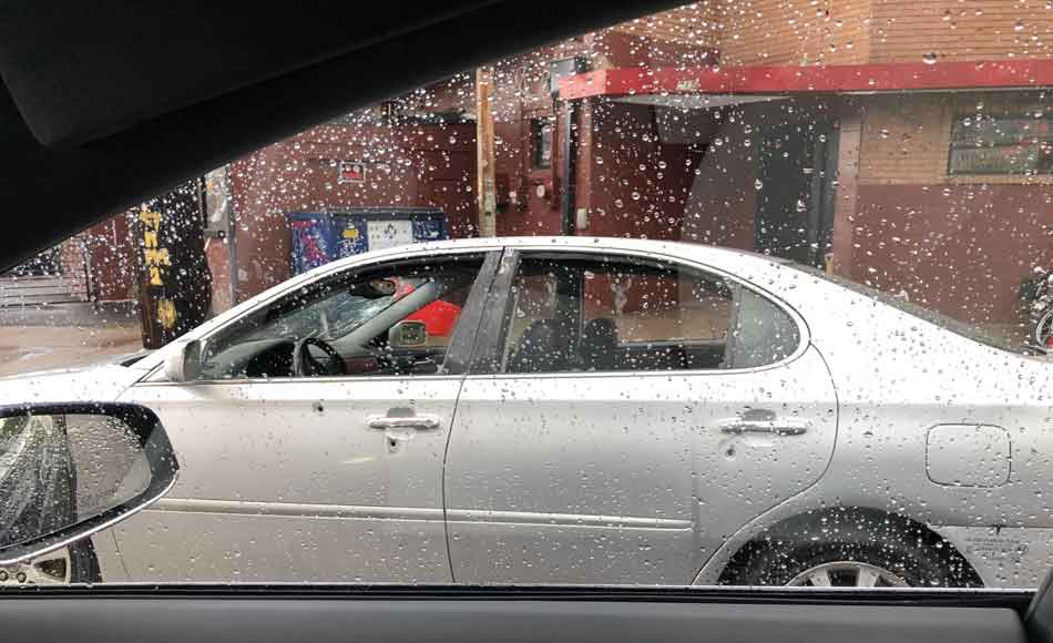 a silver car with many bullet holes in it