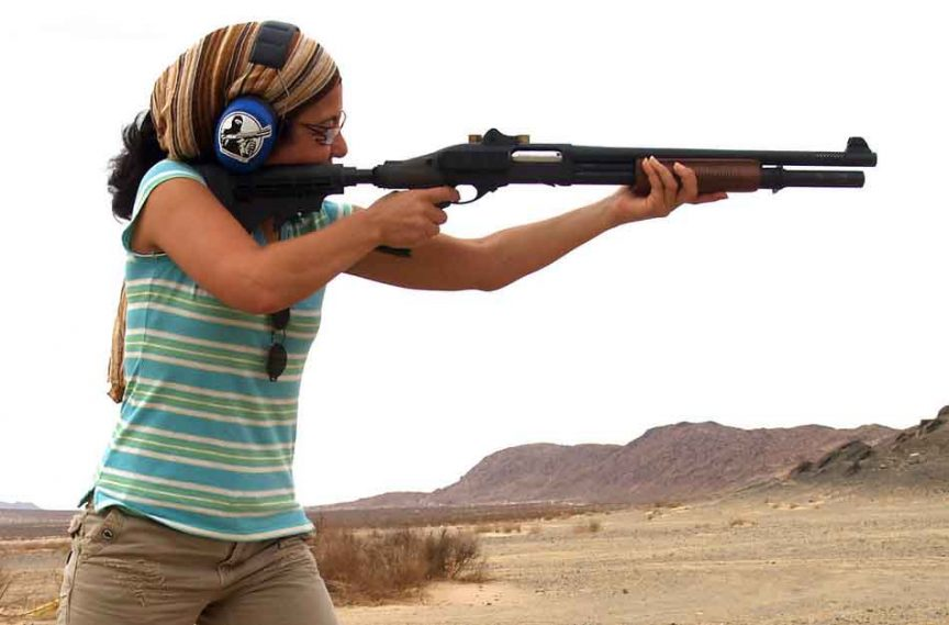 a woman with a semi auto shotgun - 12 gauge