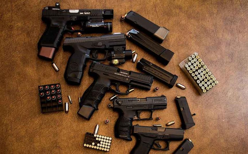 A collection of glock models on the floor