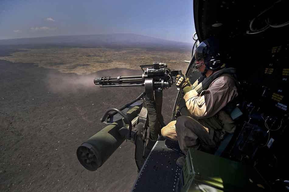 a minigun on a helicopter mount