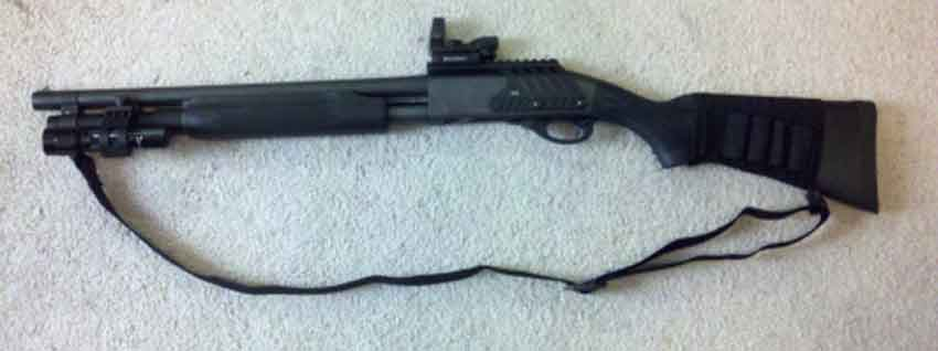 A shotgun with a red dot sight on it
