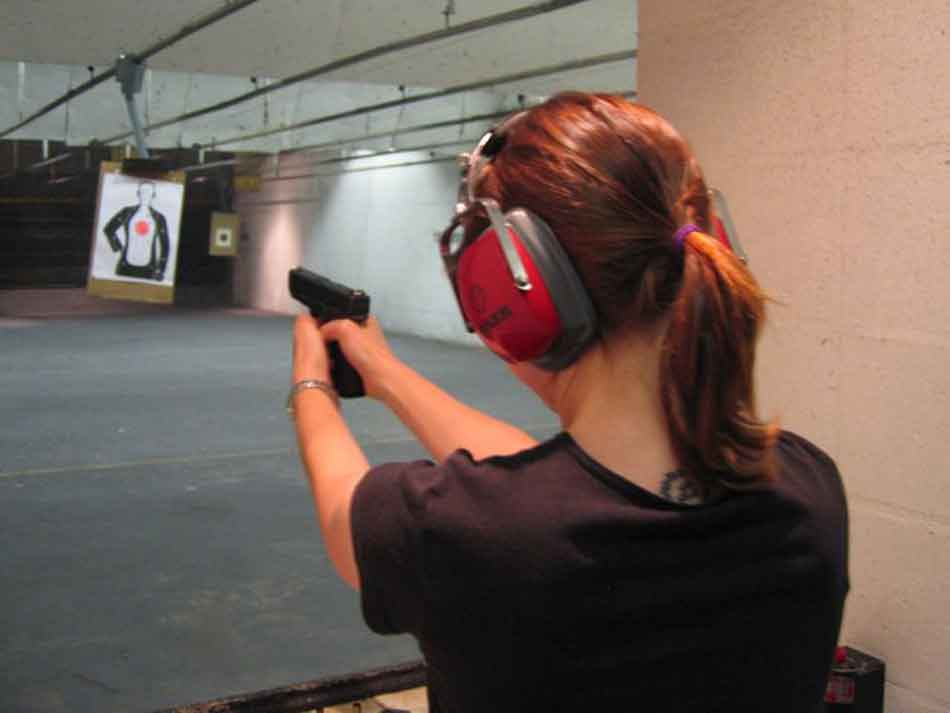 a female at the firing range with a Glock