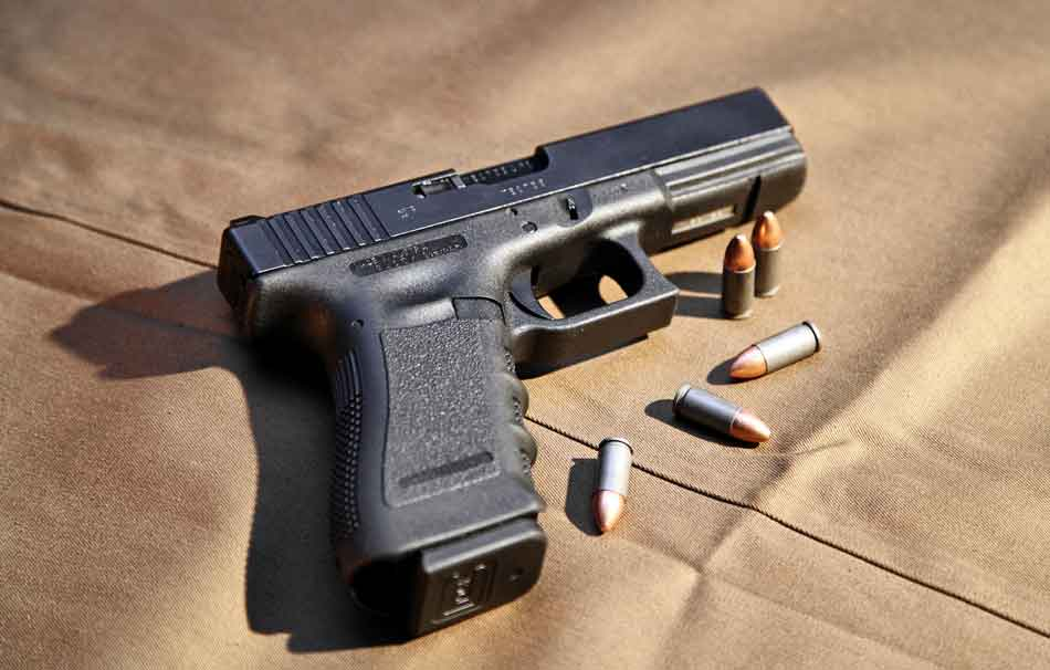 A Glock with some ammunition